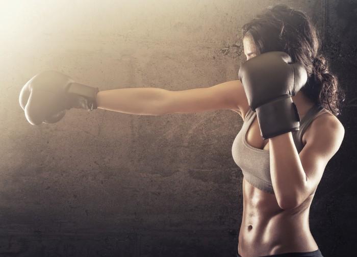 Woman punching at Journey Fiitness Kickboxing