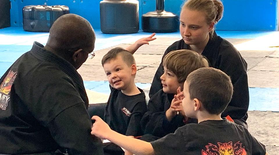 Master Johnson talks with Kindergarten Martial Arts kids